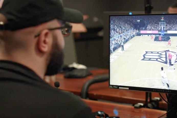 A gamer plays NBA 2K
