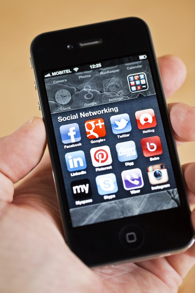 iPhone 4 with social networking apps (Getty)