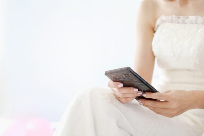 Midsection Of Bride Using Phone Against White Background