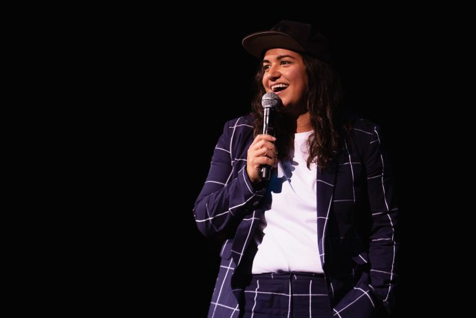 Sabrina Jalees doing stand-up in 2019