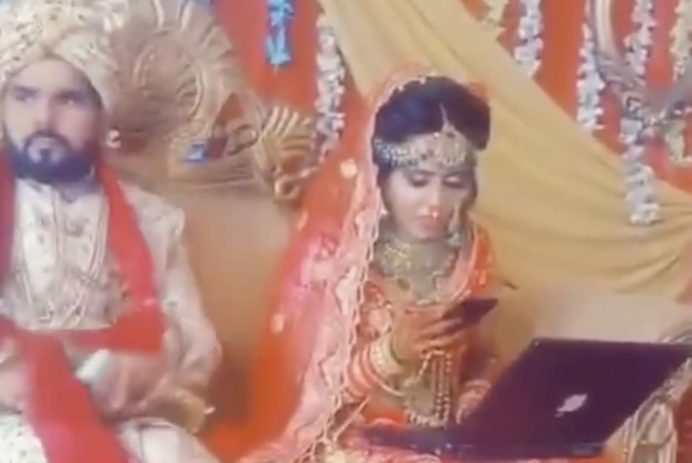 Bride works on laptop