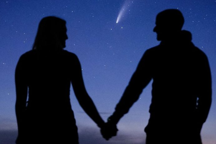 Couple gets engaged with Comet Neowise in the background.